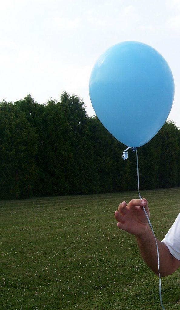 tim's hand holding balloon