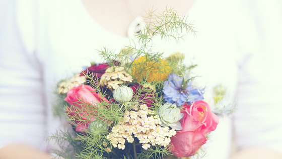 Woman holding out flowers