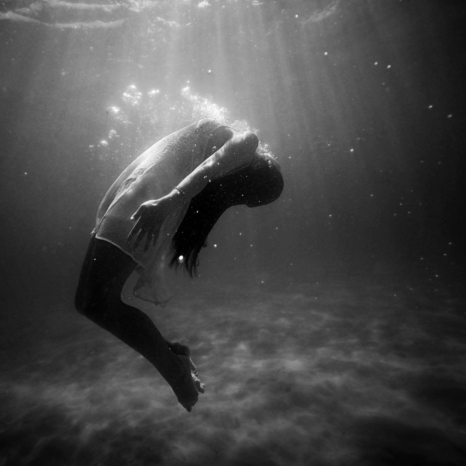 woman submerged in water