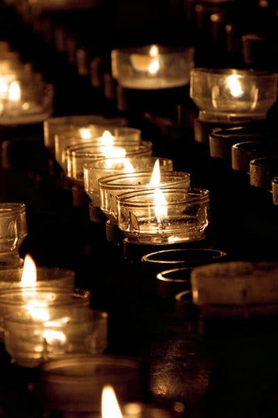 Several rows of votive candles