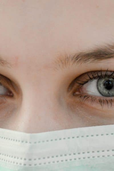 woman with surgical mask over face