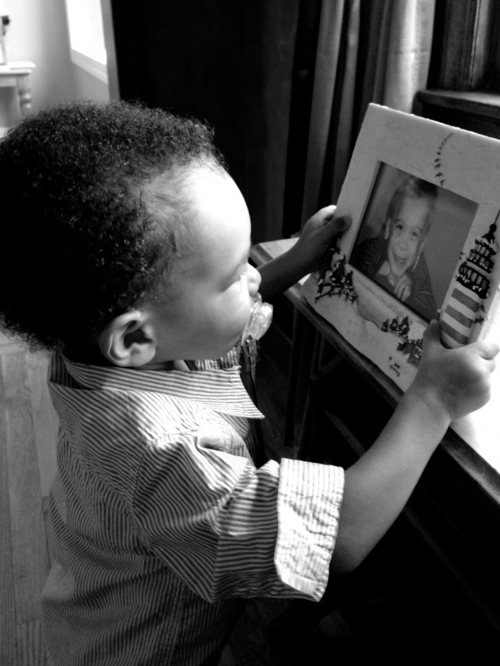 Micah holding Connors picture