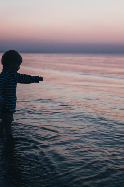 young boy at the ocean's shore