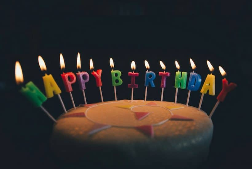 Cake with candles that say Happy Birthday