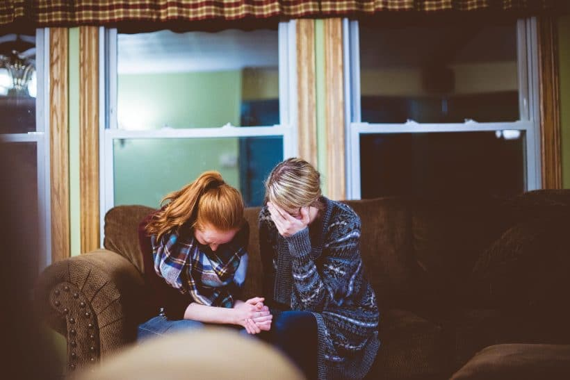 Mothering the Grieving Mother - Two grieving women sitting together