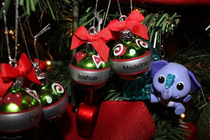 Two Christmas Ornaments with children's names: Joshua and Madeline