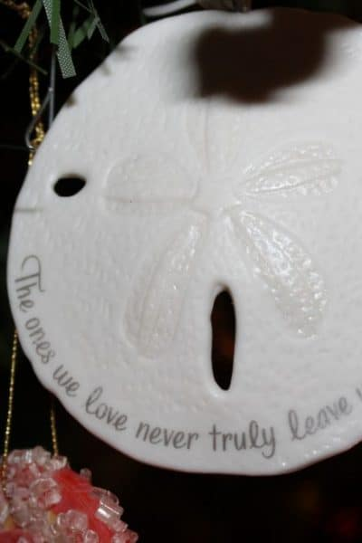 A Memorial Ornament that reads: Those who we love never truly leave us.