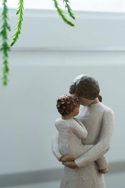 Statue of mother holding her child