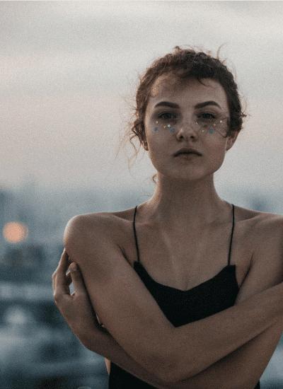 woman wearing black spaghetti strap sleeveless top