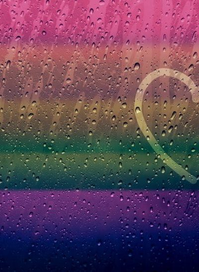 Lonely Heart Shape Drawn on glass window with Rainbow Gradient Color and droplet