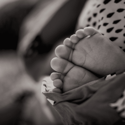 black and white of infant feet