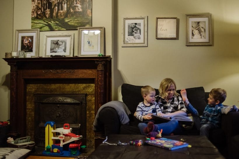 Kristin Naylor plays with her sons in their living room decorated with pictures of their stillborn daughter, Abby.