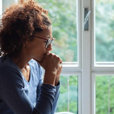 sad woman at window